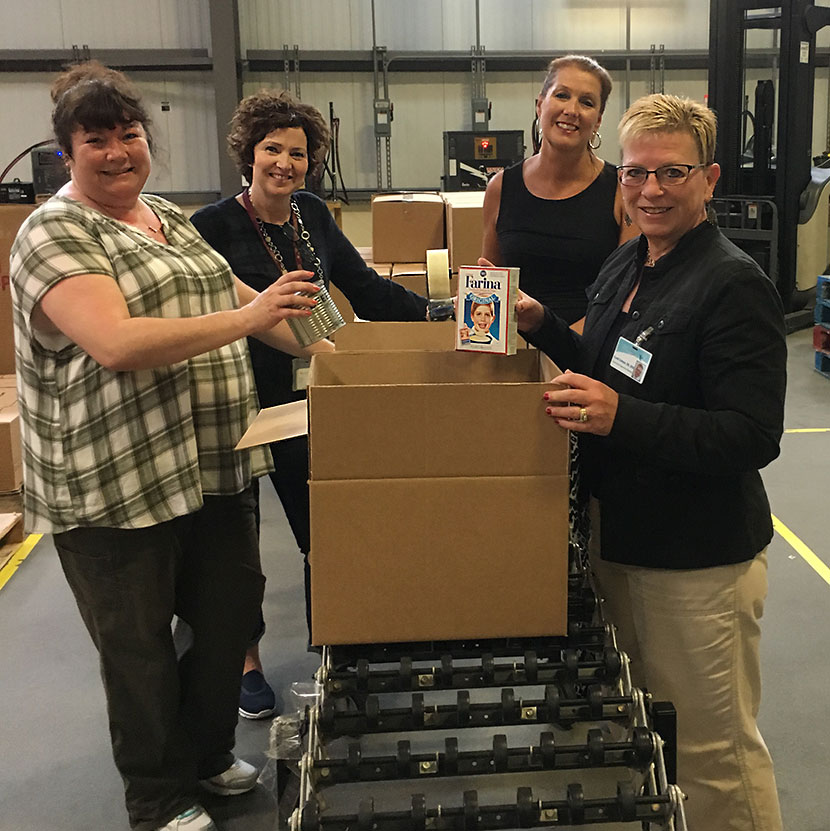 Brenda Colbert, Beth Rossi, Theresa Gilhooley and Cyndi Colman of the Northeast Aging Network Alliance (NANA) at the CEO/Weinberg Regional Food Bank